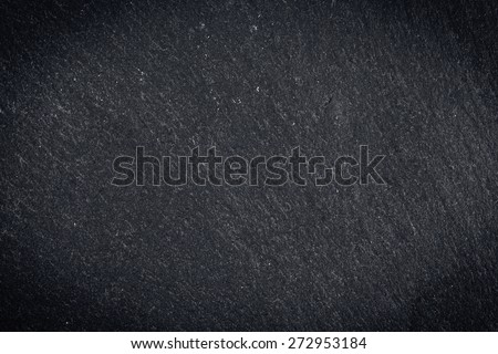 Dark gray granite texture or background with vignette - stock photo