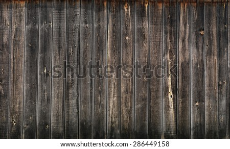 Dark gray weathered wooden boards, wood wall texture background - stock photo