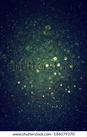 dark green glitter lights background. abstract green and black. defocused. - stock photo