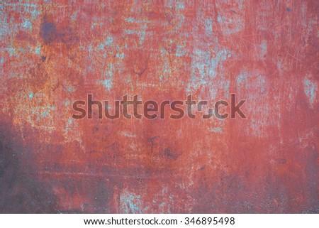 Dark green peeled rusty metal surface. - stock photo
