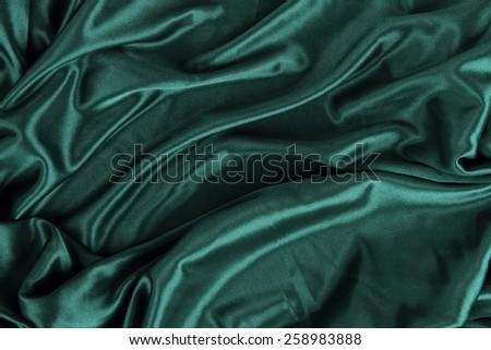 Dark Green Satin Silk Velvet Cloth Fabric Background - stock photo