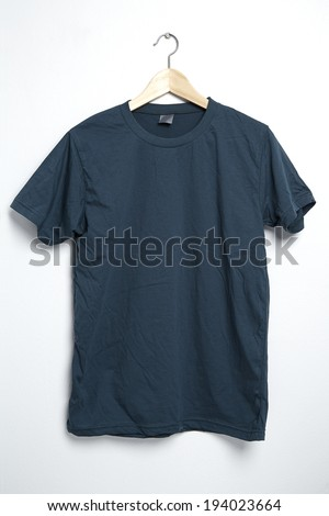 Dark green tshirt template on hanger ready for your own graphics. - stock photo