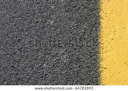 Dark grey asphalt background with yellow paint