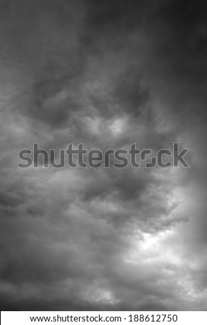 dark grey clouds in the sky before the rain. vertical photo - stock photo