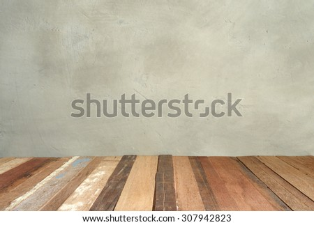 Dark grey grungy concrete wall and wooden floor , use for background