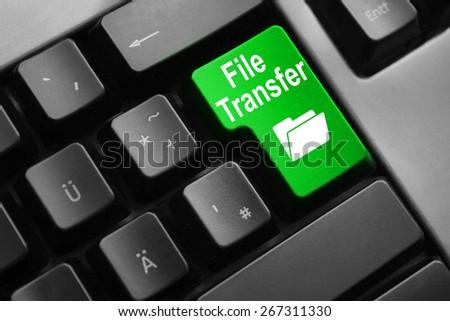 dark grey keyboard green button file transfer folder symbol - stock photo