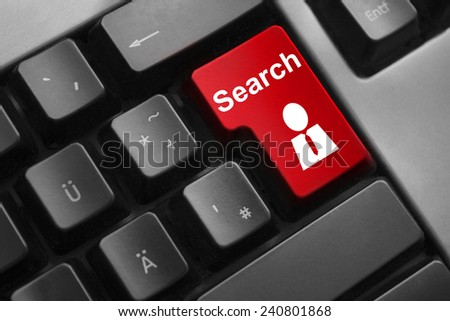 dark grey keyboard red button search employee - stock photo