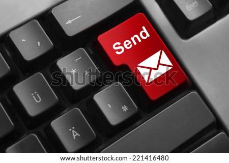 dark grey keyboard red button send mail symbol - stock photo