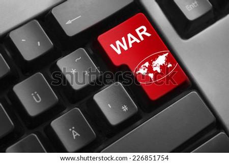 dark grey keyboard red enter button war global world symbol - stock photo