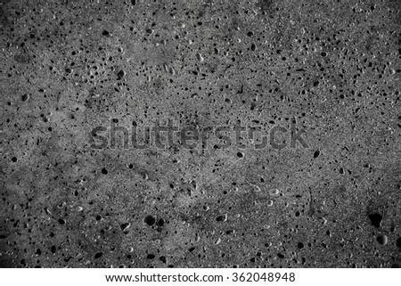 dark grey stone texture with many hole on  like a moon surface - stock photo