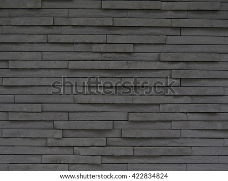 dark grey stone tile texture brick wall surfaced - stock photo