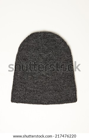 Dark grey wool beanie hat cap perfect for winter weather isolated on white background - stock photo