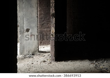 Dark grunge construction. Light falls on the destroyed wall