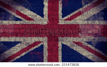 Dark Grunge Union Jack Flag on an old Brick Wall - stock photo