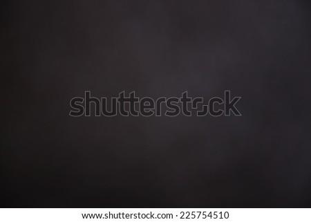 Dark Grungy black texture background with vignette - stock photo