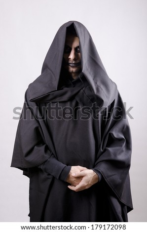 Dark guy like a sectariam with tunic costume - stock photo