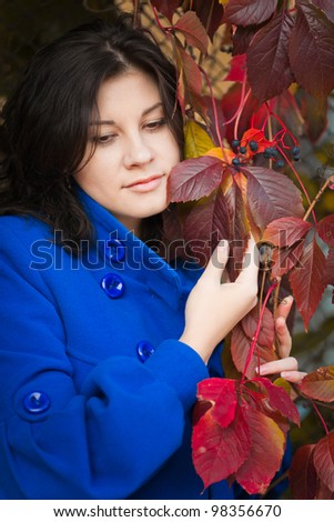 Dark-haired girl in autumn park, closeup portraite - stock photo
