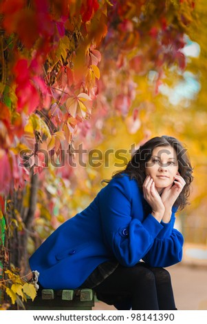 Dark-haired girl in autumn park, European, White, Caucasian - stock photo