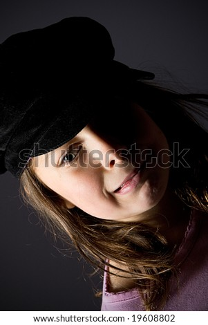 Dark Haired Girl Pulling a Funny Face - stock photo