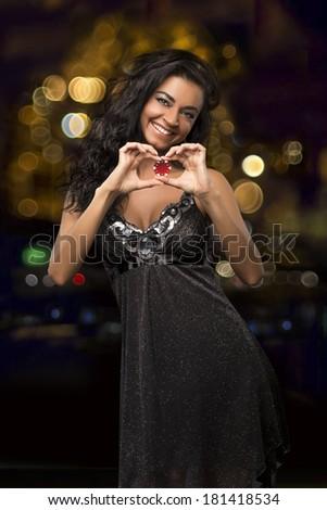 dark-haired girl with casino chips - stock photo
