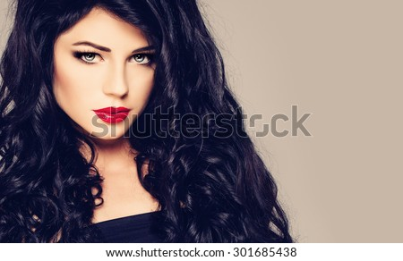 Dark Haired Woman. Brunette Girl with Curly Hair and Makeup. Fashion Portrait
