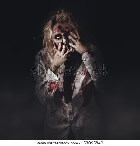 Dark halloween portrait of scary bad zombie walking through graveyard mist at night - stock photo