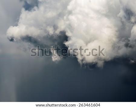 Dark heavy grey storm clouds. Dramatic sky. - stock photo