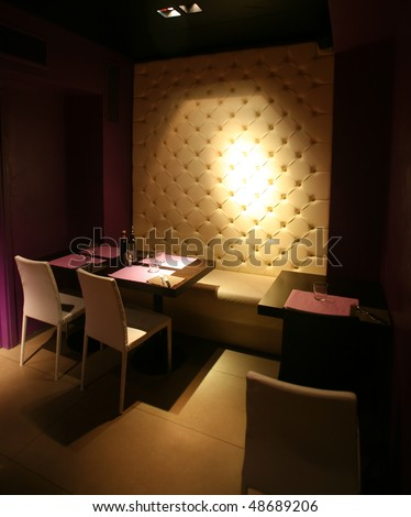 Dark illuminated modern restaurant interior at night - stock photo