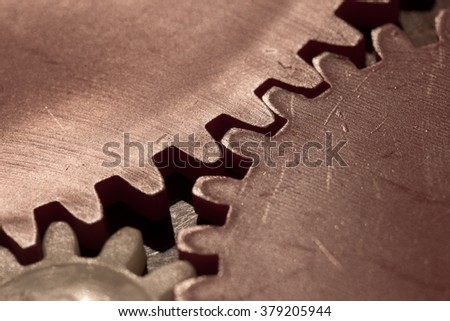 Dark image of monotone old gearwheel - stock photo