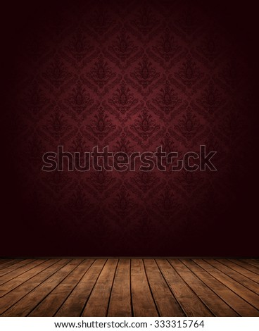 dark interior room with baroque-styled (1575-1770) wallpaper pattern.e - stock photo