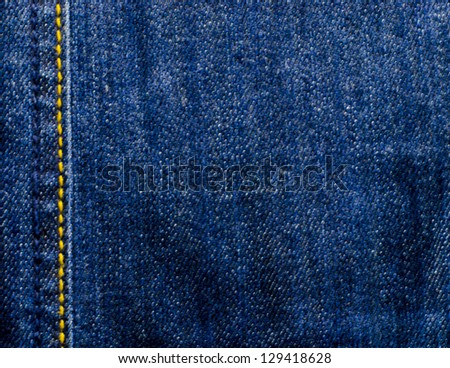 dark jean on blue color background texture - stock photo