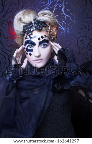 Dark Lady. Portrait of young woman in black with artistic makeup and hairstyle.