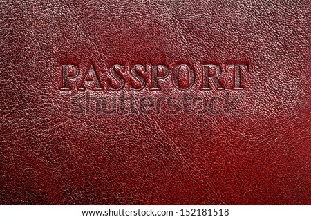 Dark leather cover for your passport, can use as background - stock photo
