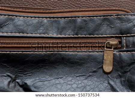 Dark leather texture and zipper background - stock photo
