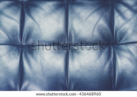 Dark leather texture of sofa closeup shot (Vintage filter effect used) - stock photo