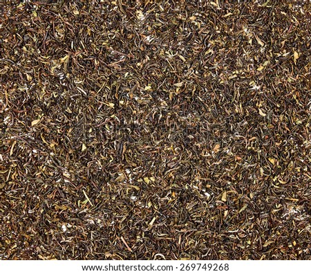 Dark loose darjeeling tea texture - stock photo