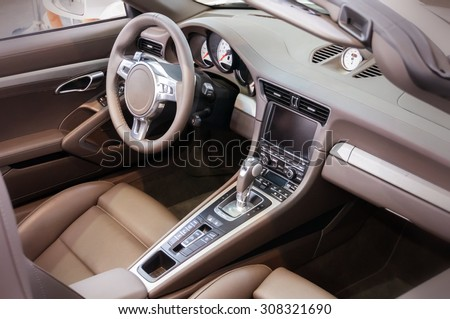 Dark luxury car Interior - steering wheel, shift lever and dashboard - stock photo