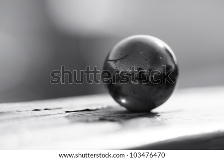 Dark marble on the fence - stock photo