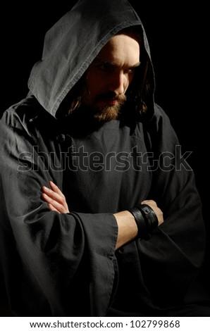 dark medieval monk over black background - stock photo
