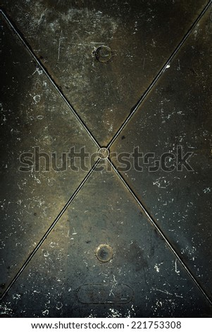 Dark metal surface with scratches and dents. - stock photo