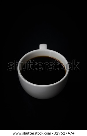 Dark moody photography with a cup of black coffee, Still life photography with a cup of black coffee
