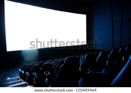 Dark movie theatre interior. screen and chairs. - stock photo