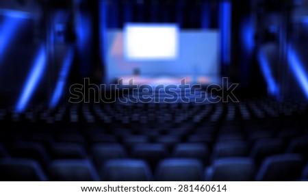 Dark movie theatre interior. screen, chairs - stock photo