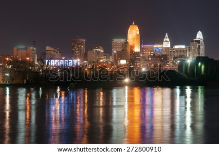 Dark Night Ohio River Cincinnati Downtown City Skyline - stock photo