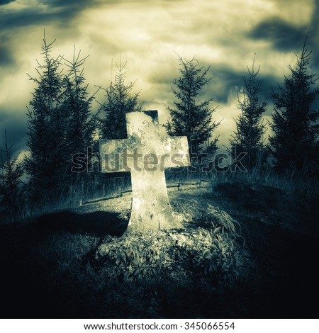 Dark night spooky landscape with abandoned grave and memory stone next haunted mysterious forest under dramatic sky. Evil and nightmare concept - stock photo