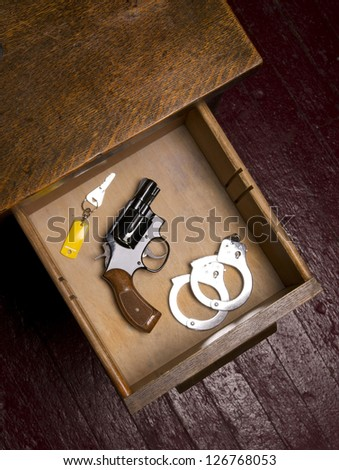 Dark Office and 38 Revolver Gun Weapon in Desk Drawer with Handcuffs