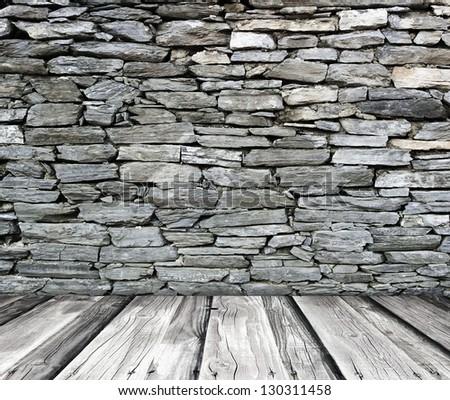 Dark old rock wall an wood floor - stock photo