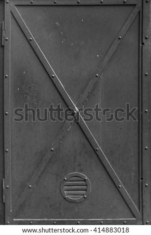Dark old vintage metal door texture.   - stock photo