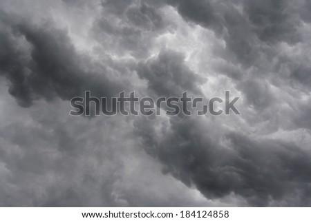 dark ominous clouds - rainy clouds - stock photo