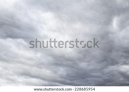 Dark ominous grey storm clouds. Dramatic sky - stock photo